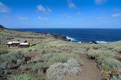 Last short descent to the Charco Manso at the northern tip of El Hierro, Canary Islands, Spain. poster