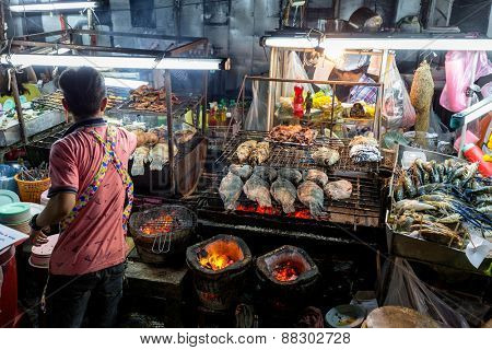 BANGKOK, THAILAND, DECEMBER 25, 2014: View on the outdoors kitchen of a street seafood restaurant in the Central World district in Bangkok, Thailand