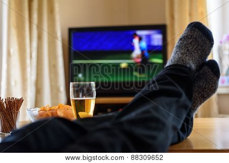 Television, Tv Watching (football Match) With Feet On Table And Huge Amounts Of Snacks