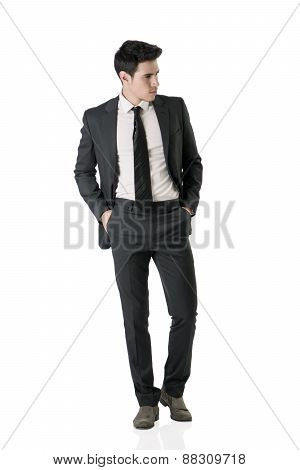 Full figure shot of handsome elegant young man in business suit