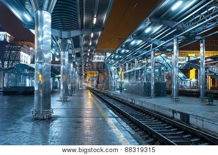Railway station at night. Train platform in fog. Railroad in Donetsk. poster