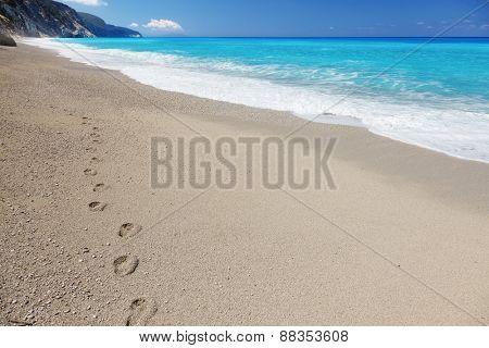 Footprints on the sandy beach, Lefkada island, Greece