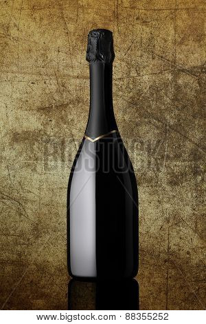 bottle of sparkling wine on colorful gold background