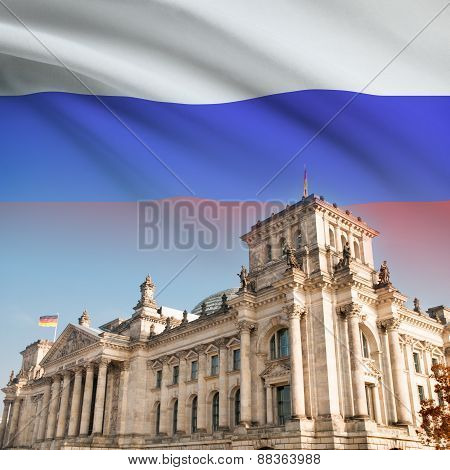 Reichstag (bundestag) Building In Berlin With Flag On Background - Russia