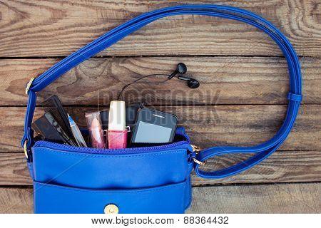 Blue women's purse. Things from open lady handbag