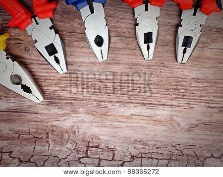 copyspace image set of pliers on wooden board