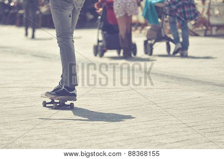 Young Male Skateboarder Riding Skateboard at City Street Pavement Selective focus Cross Process Toned Image poster