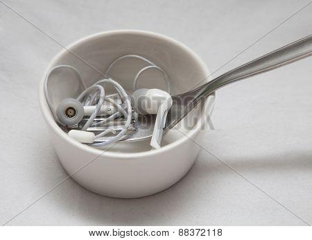Earplugs with fork in little bowl
