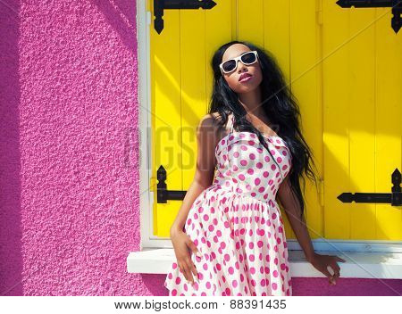 Young attractive african american woman wearing sunglasses