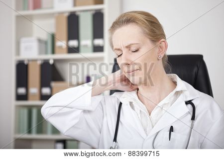 Exhausted Adult Female Doctor Touching Her Nape