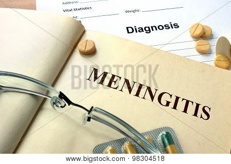 Word Meningitis on a paper and pills.