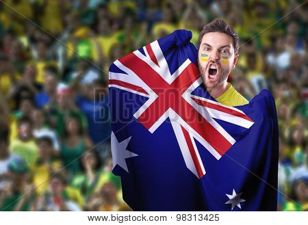 Fan holding the flag of Australia in the stadium