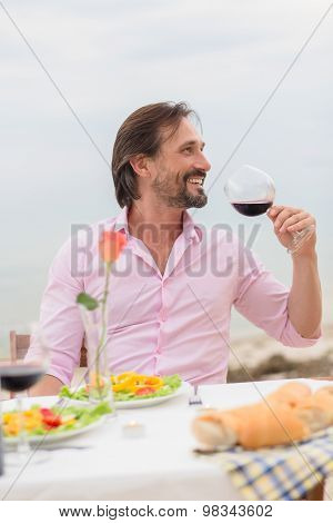 Handsome man drinking wine