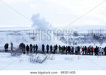 Visitors At The Geyser Erruption Of Strokkur, Iceland