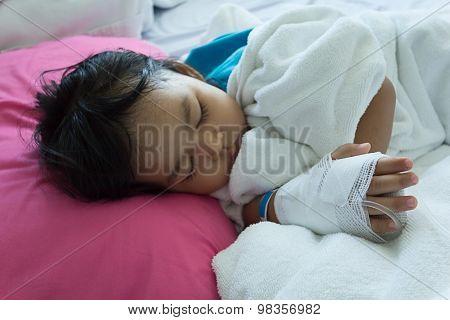 Illness Asian Kids Asleep On A Sickbed In Hospital, Saline Intravenous (iv) On Hand