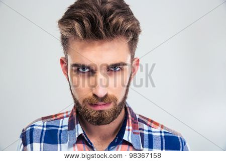 Portrait of angry man looking at camera isolated on a white background