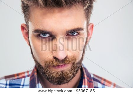 Portrait of a handsome man looking at camera isolated on a white background
