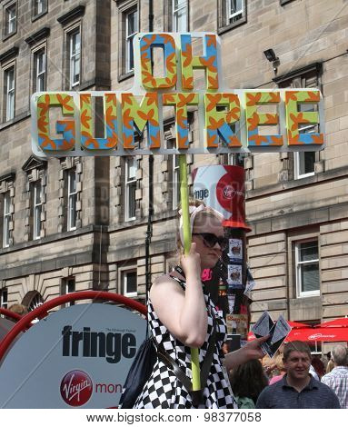 EDINBURGH - AUGUST 8: Member of Blue Suit Theatre Company publicize their show Oh Gumtree during Edinburgh Fringe Festival on August 8, 2015 in Edinburgh, Scotland