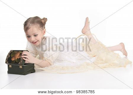 A Beauty Ballerina young girl open a tresure over white background poster