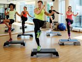 Multiracial group during aerobics class poster