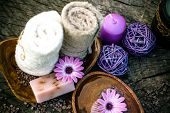 Spa and wellness setting with natural soap candles and towel. Violet dayspa nature set dayspa nature set poster