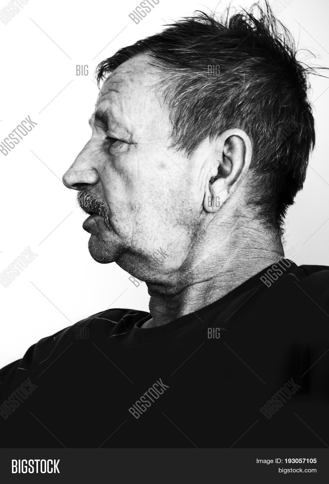 Black and white portrait isolated on white background sad old man close up