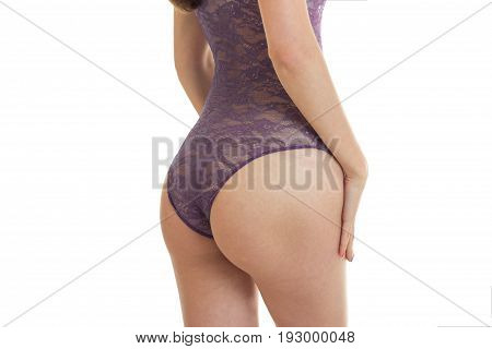 women's supple buttocks in sexual body close-up isolated on white background