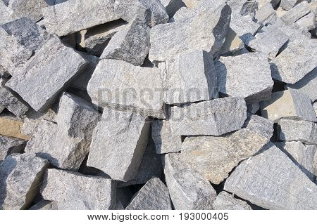 Pile of gray color stones for building the house. Background with the blocs of rectangular shaped stones