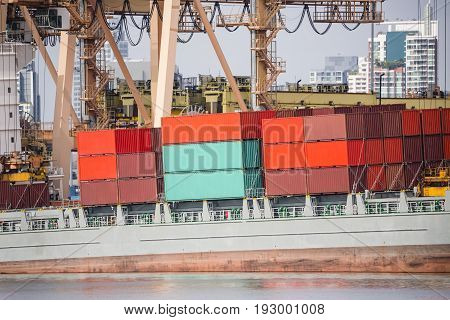 Bulk container truck lot and yellow crane harbor quayside