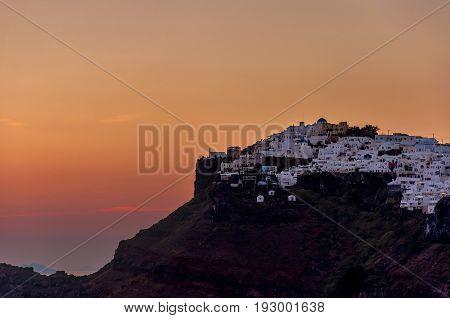 Beautiful sunset on the island of Santorini, Greece. View of Imerovigli village.