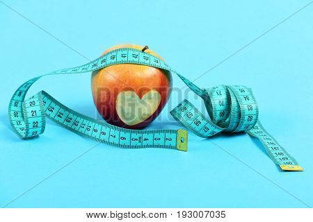 Apple With Little Heart Carved On It And Measuring Tape