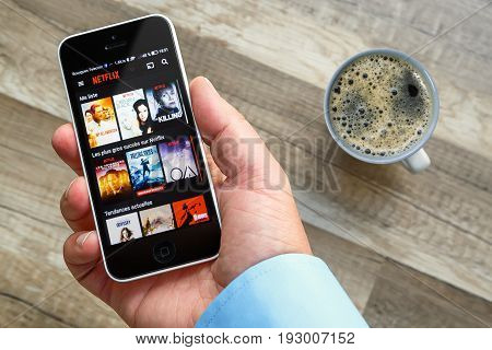 Paris, France - March 10, 2017 :man Holds A Smart Phone That Shows Movies From Netflix France. Netfl