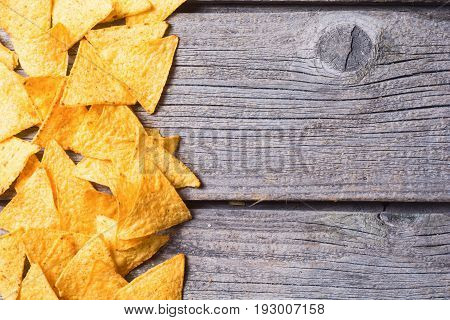 Snack for party chips nachos on wooden background . Top view