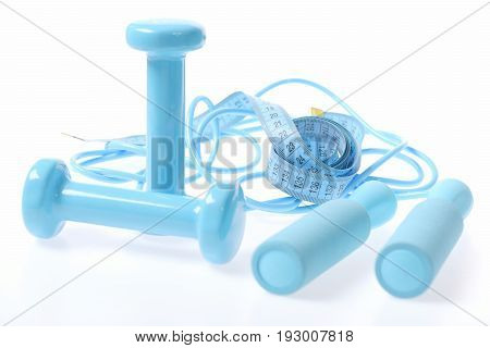 Concept Of Cyan Dumbbells Placed Crosswise And Twisted Skipping Rope