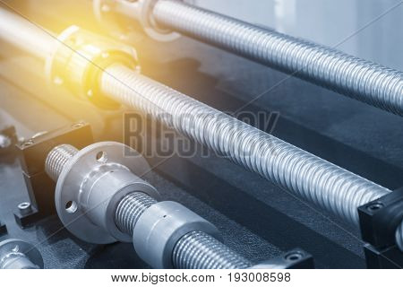 The lead screw of the CNC machine with the lighting effect scene.The spare part of CNC machine