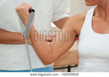 Physiotherapist And Patient With Strengthen Arm, Color Image, Indoors