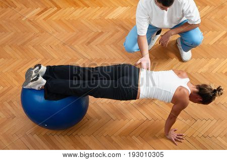 Female Practice Body Balance On Exercise Ball, Color Image, Indoors