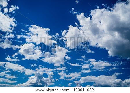 Beautiful white clouds against blue sky background copy space. Light blue sky with clouds free space