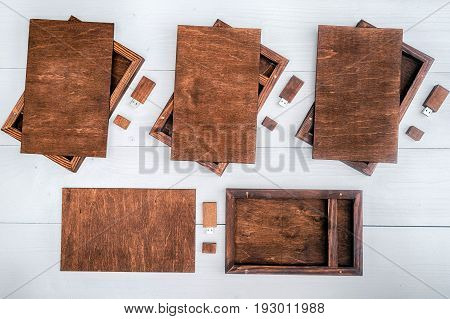 Empty wooden boxes for gift or photos with usb stick free space. Packaging for photo and USB drives on white wooden background. Information and mail concept