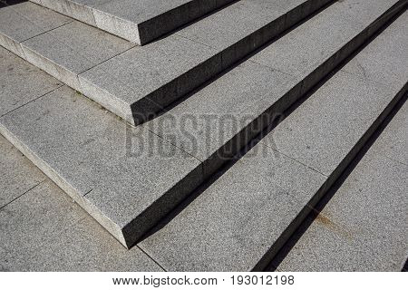 Abstract stairs in black and white, abstract steps, stairs in the city, granite stairs, wIde stone stairway often seen on monuments and landmarks, wide stone stairs, steps, black and white photo, diagonal