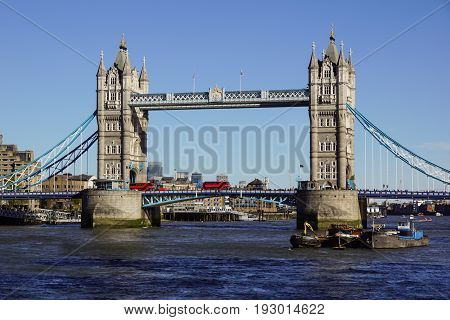 LONDON, UNITED KINGDOM - APRIL 09: Tower Bridge in London on APRIL 09, 2017. Bascule Tower Bridge Over Thames River in London, United Kingdom