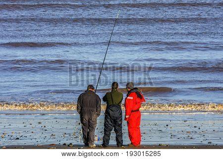 Kingston upon Hull/England - January 9 2011: Sea fisherman at sunset near Kingston upon Hull in England