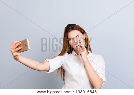 Selfie And Funky Crazy Mood!attractive Young Lady Is Making A Selfie On The Camera, Playful And Fool