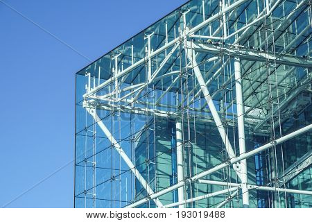 blue building all glass square patern on white sky background .