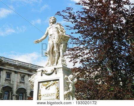 Statue of Wolfgang Amadeus Mozart against sunny blue sky, Burggarten Park in Vienna, Austria