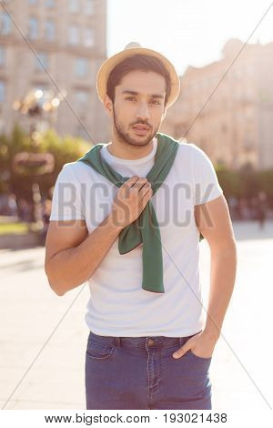 Summer Vacation Time. Young Handsome Brunet Guy With Bristle In Hat And Casual Clothes Is Walking Ou