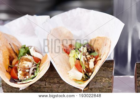 mexican open tortilla wrap with chicken breast and vegetables