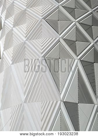 geometric diamond white patterns and cladding on wall of a modern building