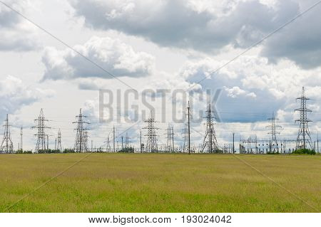 Electric substation in a green summer field