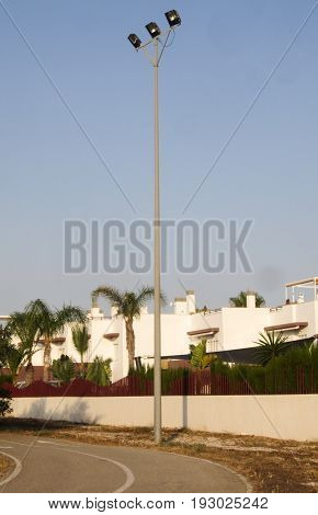 floodlight on tall pole in Spanish play area